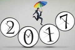 Optimistic woman jumps on 2017 Stock Photo