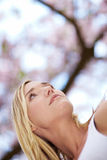 Optimistic woman in spring Stock Images