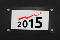 Optimistic 2015 year graph. Behind glass sheet of paper with a optimistic 2015 year graph Royalty Free Stock Photo