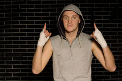 Optimistic young boxer pointing upwards Stock Images