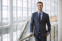 Optimistic Young Executive Modern Office Architecture. Confident happy optimistic young business man portrait modern office architecture building Stock Images