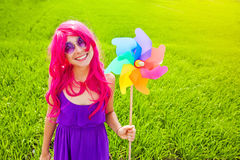 Optimistic young woman wearing pink wig Stock Images