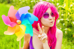 Optimistic young woman wearing pink wig Stock Image