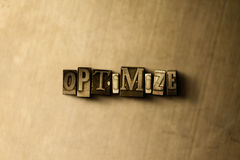 OPTIMIZE - close-up of grungy vintage typeset word on metal backdrop Stock Photos