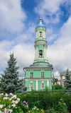 Optina Pustyn. Bell tower of the monastery garden flowers Royalty Free Stock Image