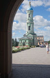 Optina Pustyn monastery. Optina Pustyn. A view of a belltower and the Temple in honor of the Kazan icon of the Mother of God from the Sacred Gate Royalty Free Stock Photo