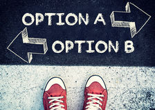 Option A and B. Student standing above the sign option A and B royalty free stock image