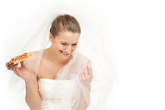 Option de tentation pour une jeune mariée - pizza Image libre de droits