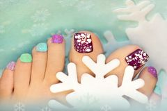 Option winter snow colorful pedicure. With snowflakes close up Stock Photos