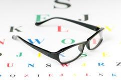Optische lezingsglazen op de lijst Stock Fotografie