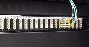 Optische schakelaar en colorfull FC-kabels Stock Afbeelding