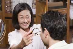 Optometrist Assisting Patient In Choosing Glasses Royalty Free Stock Photo