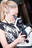 Optometrist checking eyeglasses Royalty Free Stock Image