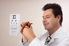 Optometrist cleaning glasses Royalty Free Stock Image