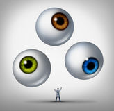 Optometrist Concept. Optometrist doctor concept and optician services symbol as a health professional juggling human eye balls as a metaphor for patient vision Royalty Free Stock Photos