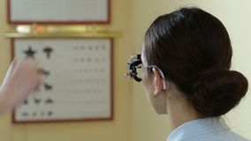 Optometrist doctor examining eyesight of patient stock video footage