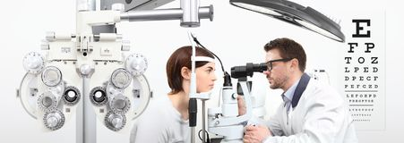 Optometrist doing eyesight with woman patient measurement with s. Optometrist doing eyesight with women patient measurement with slit lamp on white background royalty free stock photo