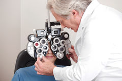 Optometrist doing Sight Testing Royalty Free Stock Image