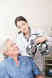 Optometrist doing Sight Testing Stock Images