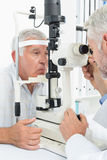 Optometrist doing sight testing for senior patient. Close-up of an optometrist doing sight testing for senior patient Royalty Free Stock Images