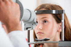 An Optometrist Doing Vision Testing Of Girl. Close-up Of An Optometrist Doing Vision Testing Of Girl Stock Image