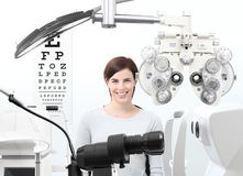 Optometrist exam, eyesight  woman patient in optician office. White background Royalty Free Stock Photography