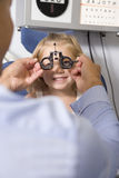 Optometrist in exam room with young girl Royalty Free Stock Image