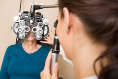 Optometrist Examining Patient's Vision Royalty Free Stock Image