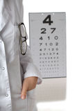 Optometrist with eye chart Royalty Free Stock Photo