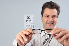 Optometrist holding eye frames Royalty Free Stock Image