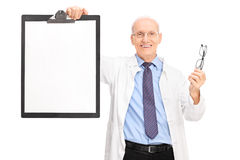 Optometrist holding glasses and a clipboard Stock Images