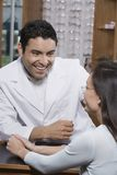 Optometrist Looking At Patient Stock Images