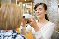 Optometrist Measuring Pupilary Distance stock photo