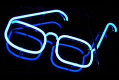 Optometrist neon sign at night stock image