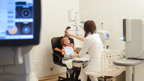 Optometrist in ophthalmology clinic checking little child`s vision royalty free stock images