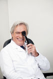Optometrist With Ophthalmoscope Stock Photos