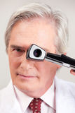 Optometrist with Opthalmoscope Royalty Free Stock Photos