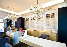 Optometrist in optician shop Stock Photography