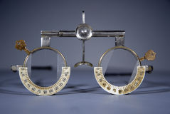 Optometrist's trial frame. Optometrist's (Opticians) antiquated trial frame with trial lenses for eyetest Stock Photo