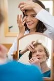 Optometrist Teaching Senior Woman To Insert Stock Photos