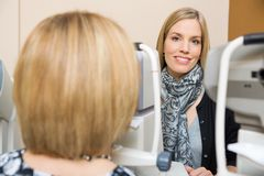 Optometrist Using Tonometer to Measure Patients Royalty Free Stock Images