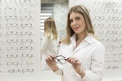 Optometrist woman looking at camera with glasses Royalty Free Stock Images