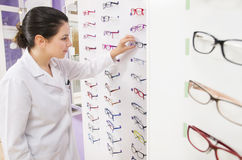 Optometrist woman looking her glasses Stock Photography