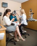 Optometrists Examining Patient In Store Stock Photo