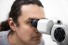 Optometry concept. Doctor tests eyesight diagnostic of patient by ophthalmology equipment in clinic. Optometry concept. Doctor tests eyesight diagnostic of stock image