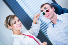 Handsome young man having his eyes examined Royalty Free Stock Image