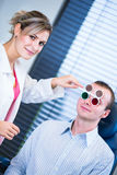 Handsome young man having his eyes examined Stock Photos