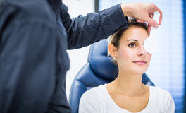Handsome young man having his eyes examined Royalty Free Stock Photo