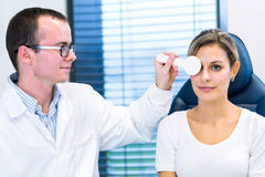 Optometry concept - pretty young woman having her eyes examined Stock Image
