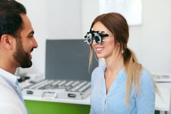 Optometry Test. Eye Doctor Checking Woman Eyesight At Clinic. Ophthalmologist Exam Patient. High Resolution stock photography